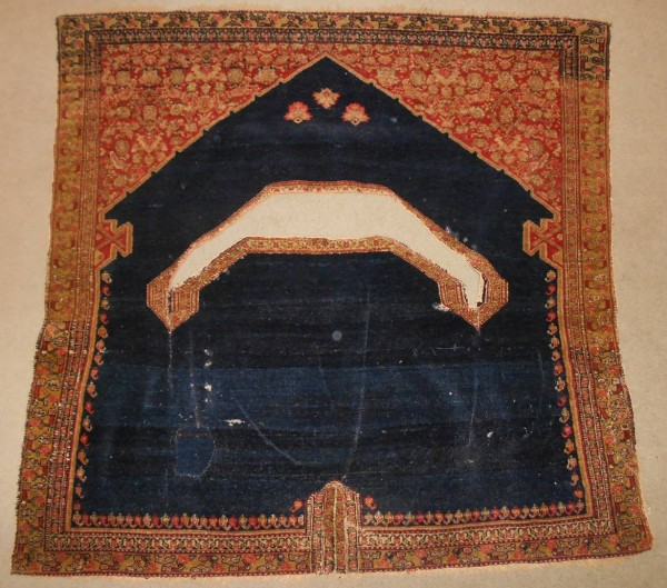 A Fine Senneh Saddle Rug