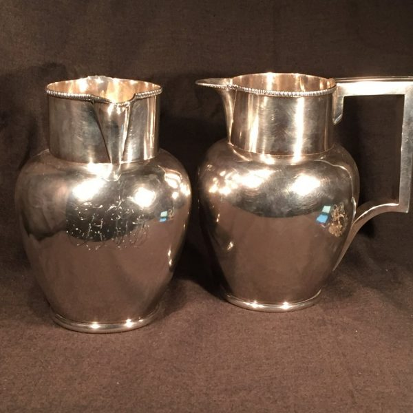 Silver pitchers marked by Charles A. Burnett and owned by Henry Foxall, the first mayor of Georgetown. They remained in the Foxall family until acquired by us.
