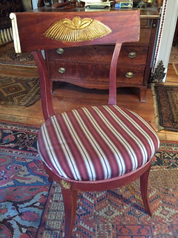 This chair belonged to Gari Melchers and is in one of his paintings. We bought it from the estate of Julian Binford and gave it back to Belmont.