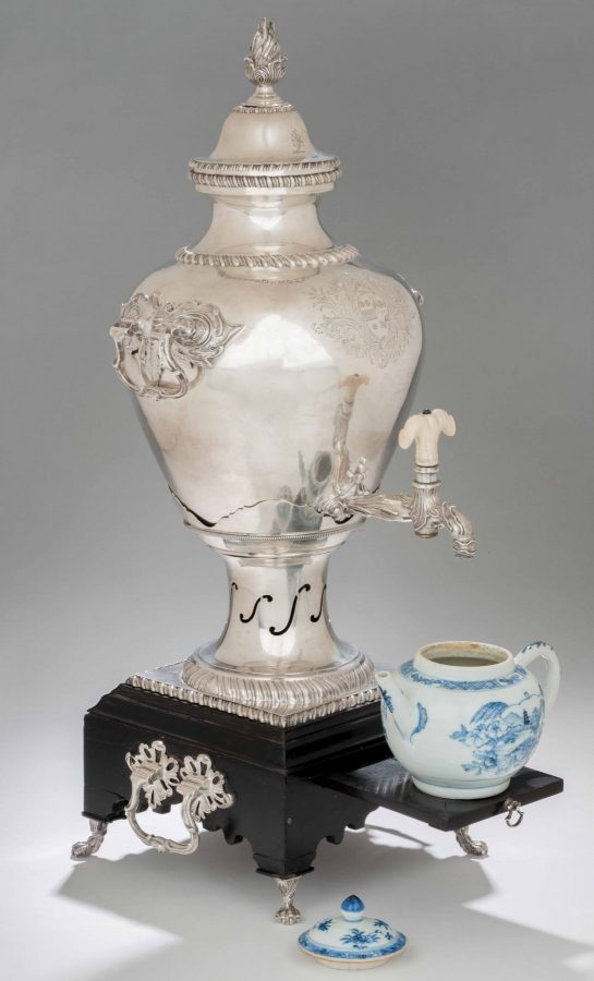This is the only Georgian silver tea urn we have ever seen with an original ebony base. It is now at Colonial Williamsburg.