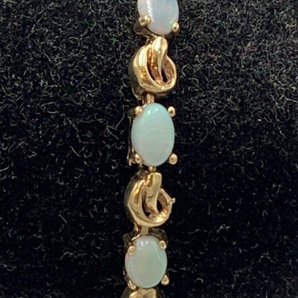 14K Gold Bracelet with 13 Opals