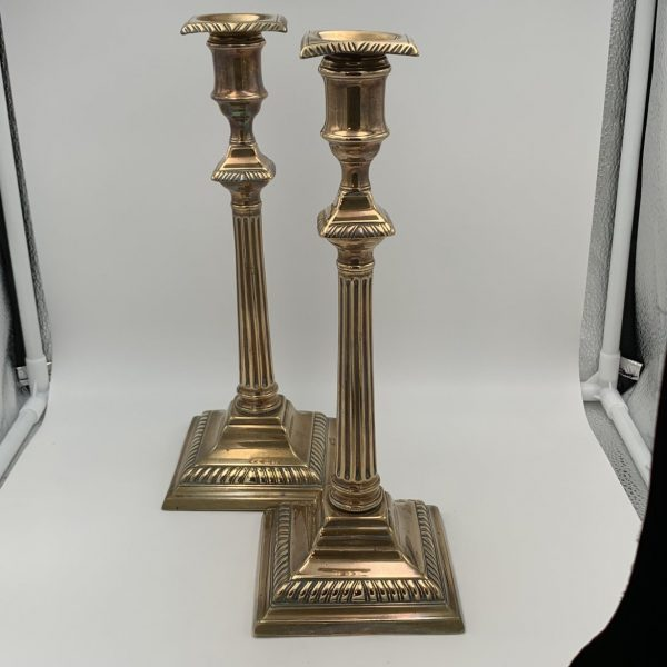 A Fine Pair of Early Neoclassical Column Form Brass Candlesticks